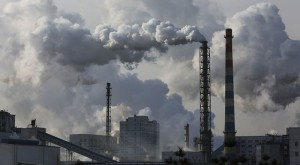China cuts pollution at home, grows coal abroad