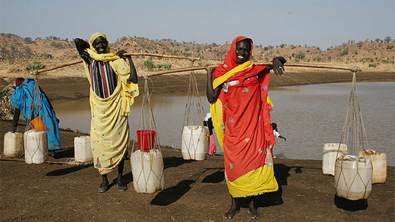 As rainfall patterns become more erratic, many women face longer walks to gather water (Pic: Practical Action/Dfid)