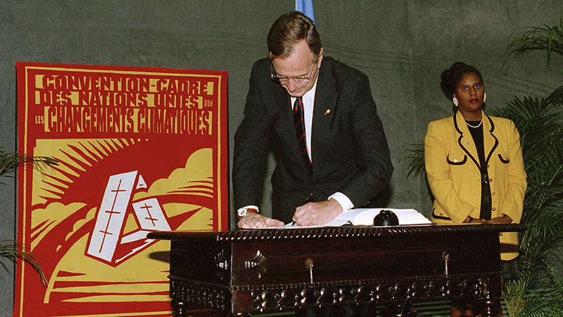 George Bush, President of the United States, signing the UN Framework Convention on Climate Change (Pic: UN Photos)
