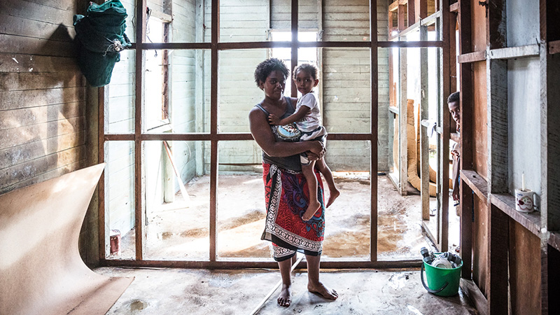 Kolora, 26, holds her daughter Semaima, 2, in what is left of her home in the aftermath of Tropical Cyclone Winston in Rakiraki district in Ra province in Fiji (Pic: UNICEF)