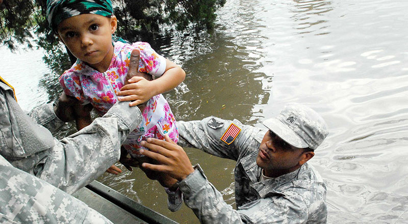 Sgt. Lee Savoy from the, Lousiana National Guard evacuates a child from the flood waters caused by Hurricane Isaac in 2012 (Pic: US Army/Flickr)