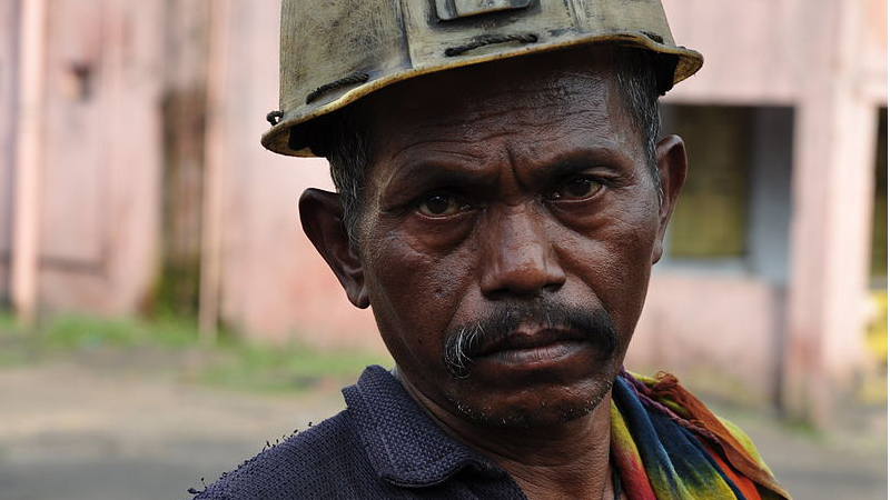 An underground coal miner in India (credit: Wikimedia commons)