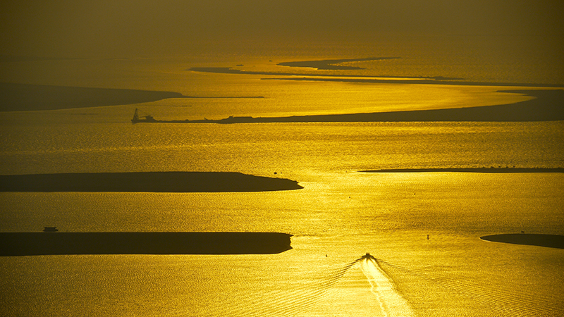 Sunset on the Persian Gulf as seen from a skyscraper in Abu Dhabi (Flickr/ Christopher Lance)