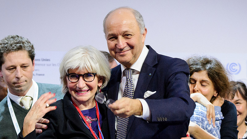 Laurence Tubiana hugs Laurence Fabius moments after the Paris Agreement was gavelled through (Pic: COP21/Flickr)