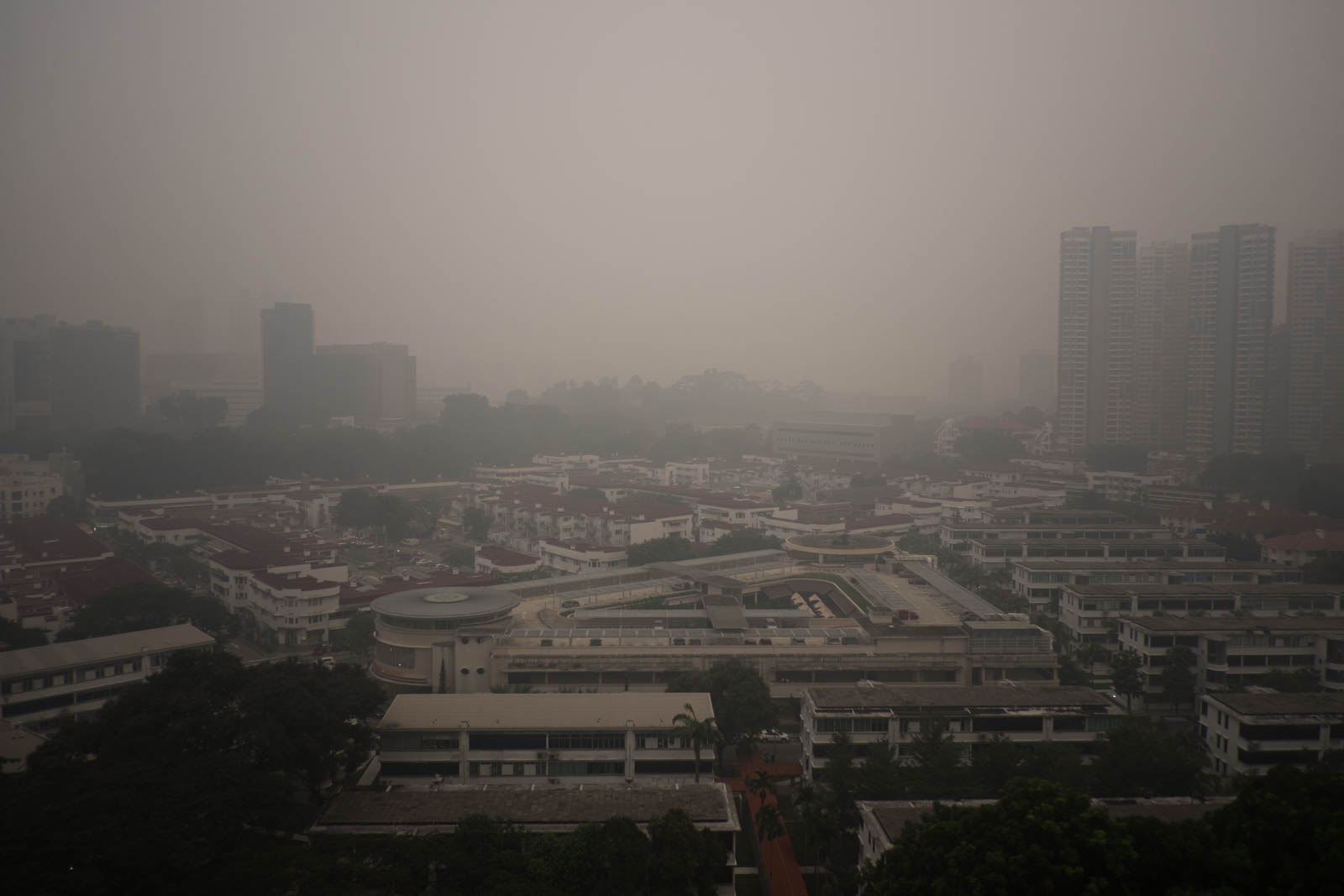 Smoke from fires in Sumatra blankets the Tiong Bahru area of Singapore in September 2015. Source: Charles EYES PiX/Flickr
