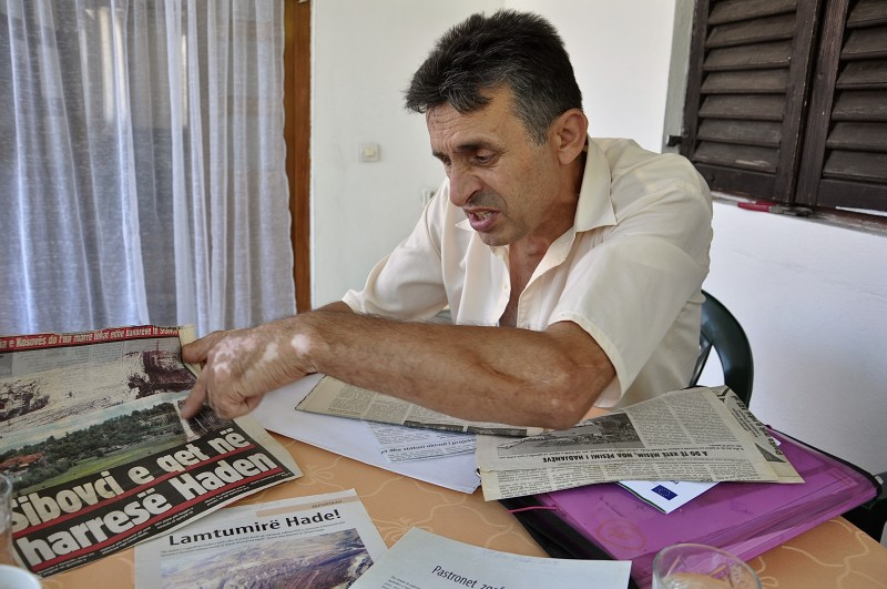 """Ragip Grajcevci fought in Kosovo guerrilla war for independence. The newspaper reads: """"Sibovc puts Hade in limbo"""". Photo: Karl Mathiesen"""