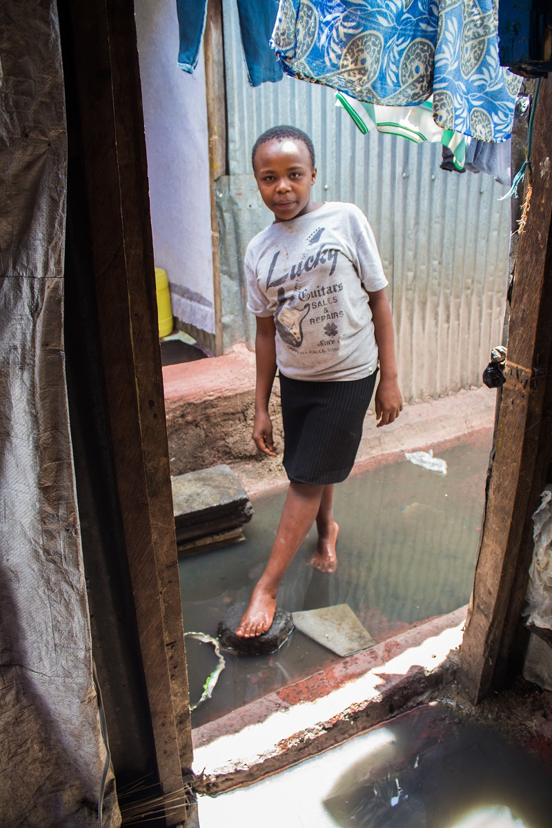 A child in a flooded home