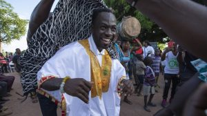 Defending Ghana's forests with seedlings, education and rap music