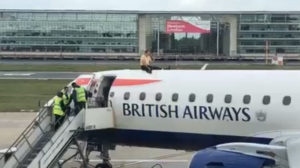 Paralympian climbs onto plane as Extinction Rebels disrupt London airport